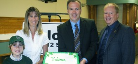 A photo of RCDSB Director of Education Roger Clarke and Chair David Kaiser and Valour School's first birthday cake